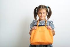 Girl with handbag Stock Photos