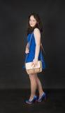 Girl with handbag Stock Images
