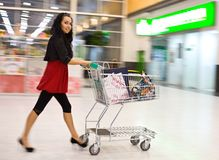 Girl with handcart Stock Images