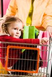 Girl in handcart Royalty Free Stock Photography