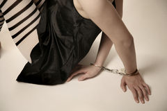 Girl in handcuffs Royalty Free Stock Image