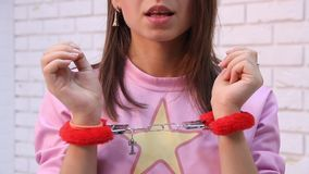 The girl in handcuffs sings. HD stock video footage