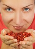 Girl with a handful of berries Royalty Free Stock Photo