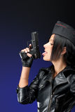 Girl with handgun Stock Images