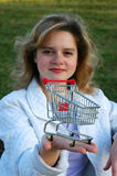 Girl handing a shopping cart Stock Photo