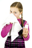 Girl with a handkerchief. Little Schoolgirl treat a runny nose with a handkerchief Royalty Free Stock Images