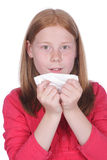 Girl with handkerchief and cold Royalty Free Stock Photography