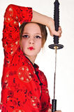 A girl handling  samurai sword Royalty Free Stock Image