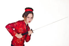 A girl handling  samurai sword Royalty Free Stock Photography