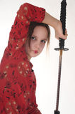 A girl handling  samurai sword Stock Photos