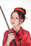 A girl handling  samurai sword Stock Photography