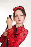 A girl handling  samurai sword Stock Images