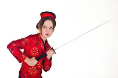 A girl handling  samurai sword Royalty Free Stock Images