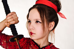 A girl handling  samurai sword Stock Photo