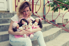 Girl with handmade dolls in the park Stock Images