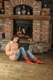 A girl in a handmade sweater and socks Stock Images