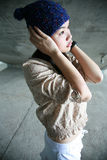 Girl hands cover ears Royalty Free Stock Image