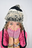 A girl with hands on face and a funny hat Royalty Free Stock Photo