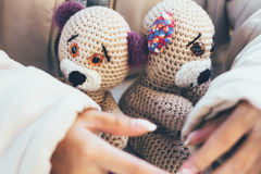 Girl hands gently hugging two teddy bears Royalty Free Stock Photo