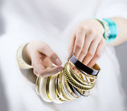 Girl hands with golden bracelets Royalty Free Stock Photography