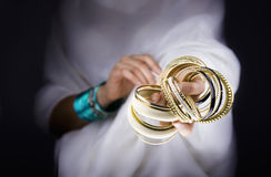 Girl hands with golden bracelets Stock Images