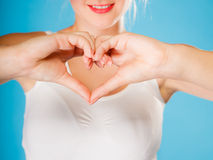 Girl hands with heart sign. Stock Photos