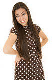 Girl hands on hip wearing brown polka dot dress Royalty Free Stock Photos