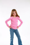 Girl with hands on hips Stock Image
