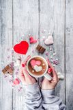 Girl Hands Hold Hot Chocolate With Marshmallow Hearts Royalty Free Stock Images