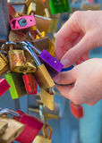 Girl hands holding padlock on bridge Stock Photos