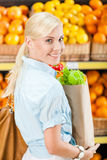 Girl hands packet with fresh vegetables Royalty Free Stock Photos