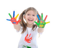 Girl with hands in a paint Royalty Free Stock Image