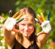 Girl with hands in the paint. Stock Photography