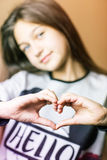 Girl with hands painted heart. Photo of a girl who hands shows heart Royalty Free Stock Image