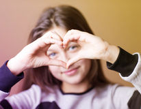 Girl with hands painted heart Stock Photo