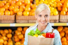 Girl hands paper bag with fresh vegetables Royalty Free Stock Photo
