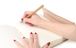 Girl hands with pencil on personal diary Royalty Free Stock Photography