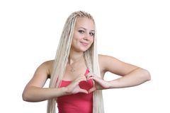The girl, hands in  shape of heart. On  white background Royalty Free Stock Image
