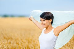 Girl hands silk scarf against rye field Royalty Free Stock Photos