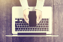 Girl hands with smartphone and laptop Stock Image