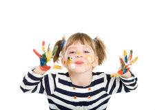 Girl with hands soiled in a paint. Stock Photos