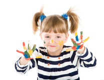 Girl with hands soiled in a paint. Royalty Free Stock Images
