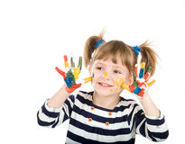 Girl with hands soiled in a paint. Royalty Free Stock Photography