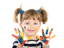Girl with hands soiled in a paint. Stock Photo
