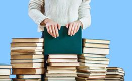 Girl hands on the stack of books Royalty Free Stock Photos