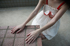 Girl with hands touching tiles Royalty Free Stock Photos