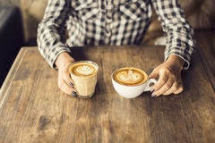 Girl hands with two cups of coffee Royalty Free Stock Photography