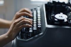 Girl hands on typewriter Royalty Free Stock Image
