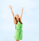 Girl with hands up in harbour Royalty Free Stock Image