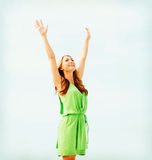 Girl with hands up in harbour Royalty Free Stock Photography